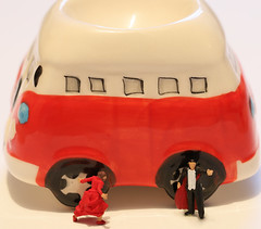 The lady in red was very pleased to see the man with the red cloak and was very excited that her dress matched the red bus.   All in all, a red letter day for her.  IMG_0715 (alisonhalliday) Tags: macromondays red macro closeup littlepeople miniatures bus vampire eggcup canoneosrp canonef100mmf28lmacroisusm