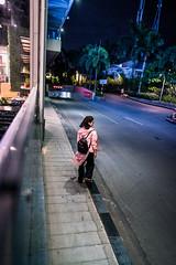 The sidewalk (Cadicxv8) Tags: girl woman street streetphotography night nightphotography people saigon aodai