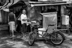 Happy man (Beegee49) Tags: street people man smiling buying breakfast happy tricycle blackandwhite monochrome sony a6000 bw bacolod philippines asia city