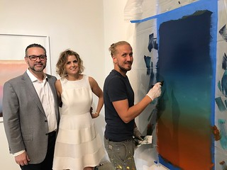 Artscape Lab owners Enrique Castillo and Georgina Chumaceiro with German artist Tomislav Topic at work during his show there at the Sunday's miami art week kick off