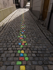 Yellow brick road (Swordscookie) Tags: rivercruise danube germany passau artsfestival colouredcobbles alley line
