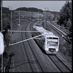 Along the Railroad Tracks (II) (Maximilian Busl) Tags: bayern deutschland hof railroad blackandwhite film analog zeiss germany traffic hasselblad ilford distagon 500cm