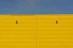 Yellow wall in symmetry (Jan van der Wolf) Tags: map199113v yellow wall muur symmetry symmetric symmetrie minimalism simple geel