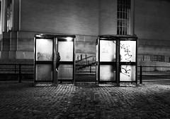 Night time telephone boxes (Hammerhead27) Tags: light urban building glass metal night booth dark bristol box telephone olympus cobbled kiosk bt graffiti