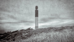 Oak Island Lighthouse (TP17) Tags: nc oakisland lighthouse tompiorkowski fujix bw beach dunes historic old