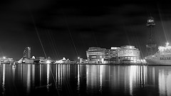 Port Vell in black (Fnikos) Tags: port porto puerto harbor sky cielo skyscape skyline water waterfront sea mar mare cloud clouds dark light lights reflections shadow shadows ship barco building tower architecture window windows mono monochrome blackandwhite absoluteblackandwhite night nightview nightshot outside outdoor