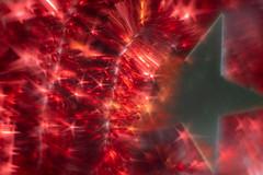 Christmas Sparkles (suzanne~) Tags: christmas red star decoration sparkle macromondays lensbaby stardisc composerpro softfocusoptic macro extensiontube