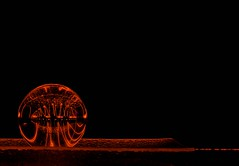 Red Glow (Karen_Chappell) Tags: red ball refraction orb sphere glass black circle round led glow lights light lightpainting longexposure stilllife abstract