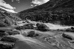 in the Scandinavian mountains, Norway (Foto-Wandern.com) Tags: fotowanderncom canoneos5dmarkiii ef2470mmf28liiusm monochrome blackandwhite scandinavien norway mountains river longexposure scandinavia nature clouds water waterfall bridge old sky fotoreise fotowandern phototour travel hiking rock rocks stream outside outdoors bw