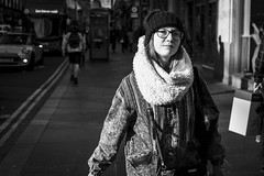 Curioser and Curioser (Leanne Boulton) Tags: urban street candid portrait portraiture streetphotography candidstreetphotography candidportrait streetportrait streetlife eyecontact candideyecontact woman female girl face eyes expression mood feeling happy happiness confidence sunlight beanie tone texture detail depthoffield bokeh naturallight outdoor light shade shadow city scene human life living humanity society culture lifestyle people canon canon5dmkiii 40mm primelens ef40mmf28stm black white blackwhite bw mono blackandwhite monochrome glasgow scotland uk