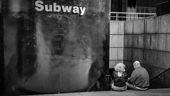 Dating in New York City (Yuri Dedulin) Tags: monochrome portrait horizontal blackandwhite candid sitting newyorkcity yuridedulin newyork ny dating decisions couples lovers meeting street suibway photoghraphy