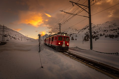 Polar Express (Artur Tomaz Photography) Tags: clouds snow swiss switzerland colors glow headlights light mountain nature sunset train warm winter railway cold