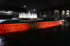The Red Zone (Derbyshire Harrier) Tags: sheafsquare 2019 reflections longexposure fountain sheffieldmidlandstation southyorkshire city sheffield red people water sculpture cuttingedgesculpture evening november winter