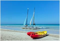At the Beach (clive_metcalfe) Tags: varadero cuba beach canoe catamaran ocean sky sand sail mast caribbean
