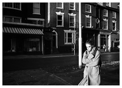 If Looks Could Kill (Dave Button) Tags: streetphotography street girl woman unhappy walking winter nottingham citycentre cold border xpro2 xf23mmf2wr 23mm fuji fujifilm mono monochromatic bw acros blackandwhite face composition pavement road pedestrian gaze