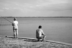 At the lake (peer.heesterbeek) Tags: lake mazurisch poland water people blackwhite monochrome fishing