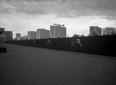 Katowice, Poland. (wojszyca) Tags: fuji gsw680iii 6x8 120 mediumformat fujinon sw 65mm bergger pancro 400 hc110 epson v800 city urbanlandscape socialistmodernism construction fence dolarowce nospr katowice modernism towerblock