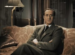 Sherlock Holmes (Basil Rathbone) looks apprehensive, as well he might!
