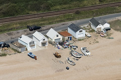 Fishing huts in Normans Bay near Bexhill-on-Sea in East Sussex - aerial image (John D Fielding) Tags: bexhill bexhillonsea beach fishing coast coastal coastline seaside huts above aerial nikon d810 hires highresolution hirez highdefinition hidef britainfromtheair britainfromabove skyview aerialimage aerialphotography aerialimagesuk aerialview viewfromplane aerialengland britain johnfieldingaerialimages fullformat johnfieldingaerialimage johnfielding fromtheair fromthesky flyingover fullframe cidessus antenne hauterésolution hautedéfinition vueaérienne imageaérienne photographieaérienne drone vuedavion delair birdseyeview british english rx374 boat nn759 midnightsun rx51