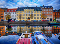 River Reflections in Copenhagen, Denmark (` Toshio ') Tags: toshio copenhagen denmark europe danish scandinavia european europeanunion christianhavn river harbor reflection boat building colorful stern fujixe2 xe2 leaves fall autumn car riverbank tree sky clouds
