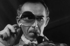 Martin Fric plays Sherlock Holmes, who must find a double to impersonate the King of Puerto Rico [sic]