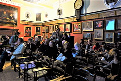 Members and guests settle themselves in the picture-hung Hall of the Art Workers Guild (photo by Roger Johnson)