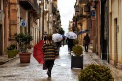 Controcorrente (encantadissima) Tags: alcamo sicilia pioggia ombrelli street
