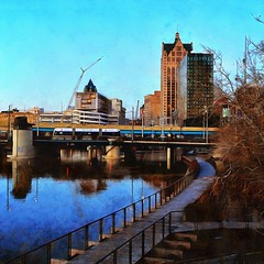 """Digital Painting: Hop westbound across the Milwaukee River, early December  evening (johndecember) Tags: december fall autumn 2019 milwaukee mke wisconsin usa album gallery onthehoproute thehopmke brookvillelibertymodernstreetcar 21stcenturytransit 21stcenturystreetcar transit gobystreetcar digitalpainting dynamic auto painter"""""""
