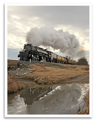 Reflecting on UP4014 (bogray) Tags: unionpacific bigboy up4014 kingofsteam steamengine locomotive 4884 greatraceacrossthesouthwest chargeacrosskansas neodesha kansas vintage classic historic restored preserved reflection