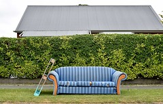 couch (stephen trinder) Tags: stephentrinder stephentrinderphotography aotearoa godzone kiwi landscape nz newzealand christchurch christchurchnewzealand thecouchesofchristchurch sofa sofafree settee couch stripey dumped unwanted used secondhand furniture suiteas hedge kerb roof pathway sidewalk pavement