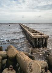 Where the sea is mocha (Cadicxv8) Tags: vietnam sea brown cafe mocha water sky beach stone shore coast wave
