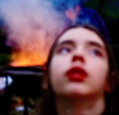 (Little) Joan of Arc (Max Sat) Tags: blur blurry feu firework flou fuji fujifilm fujinon fujixe1 girl jeannedarc joanofarc redneon rouge smoke woman xe1 xf60 unexplored maxsat maxwellsaturnin