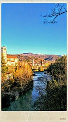 La storia di una cittadina e del suo fiume (color raimbow) Tags: littletown river beautifulview autumnview beautifulnature architecture towers churches trees goldenlight easternprealps hills landscape italy easternalps snowypeaks