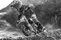 La relève est assurée ....... (Elyane11) Tags: magland motocross 9ans enfant moto conduite sport noiretblanc regard france children casque