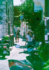 Where the streets needs no name🇬🇷 (Niemand Classical Photography) Tags: konicavx200 canoneos300v solutionvx200 tamron28105mmf456 greece street streetphotos nissiros mandraki νίσυροσ μανδρακι girl beauty leaves flowers colours colourful vx200 summer hot analogphotos analogowo filmphotography film plustek7200i plustek people classicphotography classy ishootfilm istillshootfilm ilovefilm city expiredfilm expired 35mm photography wakacje lato natural