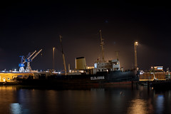 "Old Danish Icebreaker ""Elbjørn"" by night (Rind Photo) Tags: ship shipyard historic night longexposure lowlight harbour frederikshavn denmark nikond700 preainikkor55mmf12 rindphoto clauschristoffersen reflections atmosphere scrapyard romantic lights cranes"