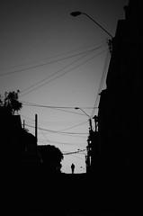 Bajo La Telaraña Urbana (natan_salinas) Tags: nikon clouds nubes mar sea cloudy paisaje landscape nube cielo sky bn blackandwhite monocromático valpo bw blackwhite blanconegro blancoynegro valparaíso ocaso atardecer arrebol sunset sunshine summer lateafternoon flush blush glow twilight crepúsculo contraluz backlighting backlight chile d5100 50mm monochrome gente look people city ciudad calle noiretblanc luz light shadow sombras silhouette silueta man hombre male streetphotography fotografíaurbana fotografíacallejera urbe urban urbano