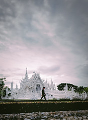 Late Chill Stroll at Wat Rong Khun (toastal) Tags: northernthailand thailand watrongkhun chill composition evening landscape man sky vibrant walking whitetemple happyplanet asiafavorites