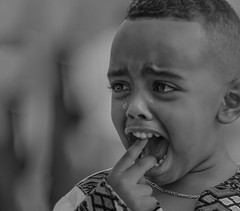 The Crying Boy (ybiberman) Tags: israel jerusalem oldcity alquds christianquarter churchoftheholysepulchre deirelsultan meskel boy crying tears tear ethiopian portrait candid streetphotography pain documentary bw blackandwhite