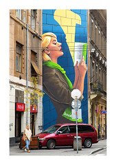 E S C A P E (Andrew Hocking Photography) Tags: budapest hungary jewish quarter district streetphotography street mural spiceofeurope europe winter november painting book reading art overcast akacfa candid blur motionblur lady car buildings architecture