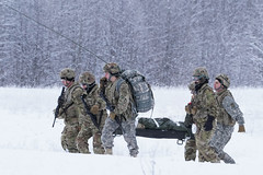 """Medics carry a simulated casualty to an extraction point while training with aviators from Alaska ANG (#PACOM) Tags: alaska unitedstates jointbaseelmendorfrichardson alaskamedevacsoldiersjberusarmy """"usindopacificcommand usindopacom"""""""