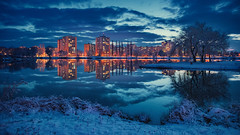 First snow 2. december (Slávka K) Tags: blue bluehour city evening snow december 2019 firstsnow sky clouds lake mirror reflection light landscape nature houses winter cold warmlight slovakia symmetry atmosphere colours