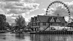 Ferris Wheel (rainerpetersen657) Tags: gdansk poland polska polen danzig ferriswheel riesenrad water river houses blackandwhite bw blancoynegro monochrome noiretblanc noirblanc monotone sony sonyalpha travel 50mm