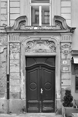 Pipe Dream (WalrusTexas) Tags: bratislava jugendstil door drainpipe brokenpediment reflection monochrome bw blackwhite wall window