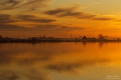 Rural Skyline of the city of Amsterdam (Johan Konz) Tags: rural skyline city amsterdamnoord evening sunset outdoors landscape waterscape water reflection orange sky cloud amsterdam netherlands waterland lake nikon d7500 elitegalleryaoi bestcapturesaoi aoi