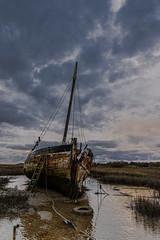 Salt Marsh Souvenir (selvagedavid38) Tags: essex leighonsea boat saltmarsh mud tidal coast wreck mast sky clouds thames river shore art decay abandonded wreckage