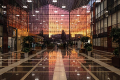 Sirius Park (gubanov77) Tags: businesscenter building architecture atrium siriuspark sunset moscow russia sunlight goldenhour glass hall lines nagatinosadovniki people parallels symmetry reflection realestate urban city cityscape