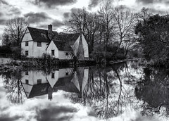 I seem to recognise this from somewhere (David Feuerhelm) Tags: monochrome mono bw blackandwhite noiretblanc schwarzundweiss blancoynegro contrast wideangle building cottage water pond millpond reflection autumn trees suffolk constable scene england flatford nikkor 1635mmf4 nikon d750