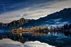 Senza foglie (giannipiras555) Tags: lago inverno montagna alberi colline nuvole fumo riflessi idro panorama natura landscape paesaggio