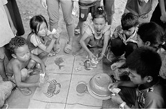 Place Your Bets (anthonypond) Tags: 35mmsummilux cambodia hp5 ilfordhp5 leicam7 nikoncoolscanv rodinal150 siemreap vuescan analog bw film